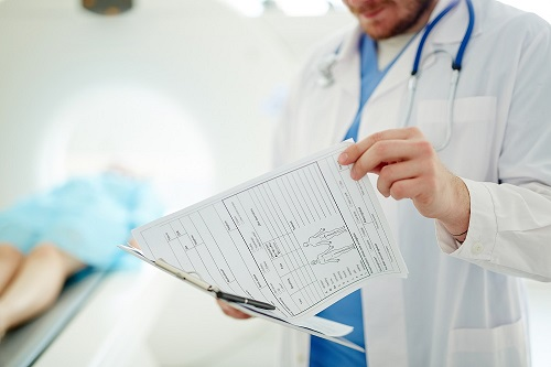 Physician reviewing documentation